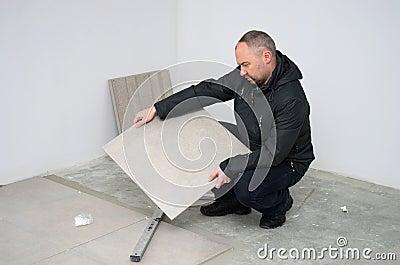 Man with new floor tiles