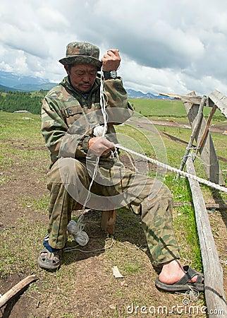 Man nomad weaving rope