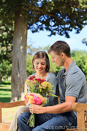 Man offering flowers to his girlfriend