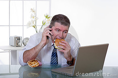 Man at office eat unhealthy food