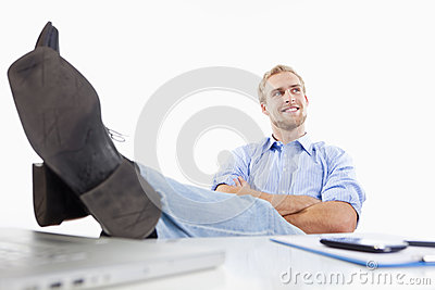 Man at office with feet on the desk