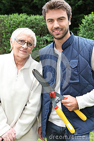 Man and older woman in garden