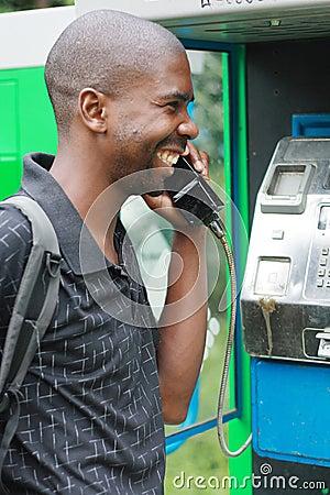 Free Man On Public Phone Royalty Free Stock Photo - 5101525