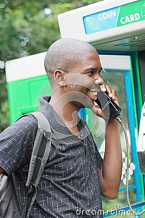 Free Man On Public Phone Royalty Free Stock Photos - 5101568