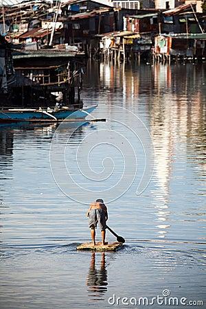 Free Man On Raft - Squatter Shanty Area Stock Photos - 18795753