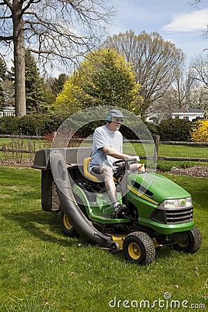 Free Man On Riding Lawn Mower Stock Image - 9034291