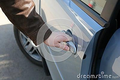 Man is open the door of car