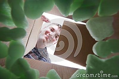 Man opening into cardboard box