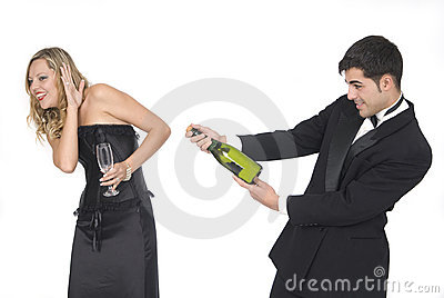Man opening a champagne bottle at a party