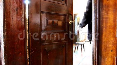 Man Opens Old Door And Enters Bright Room Stock Footage
