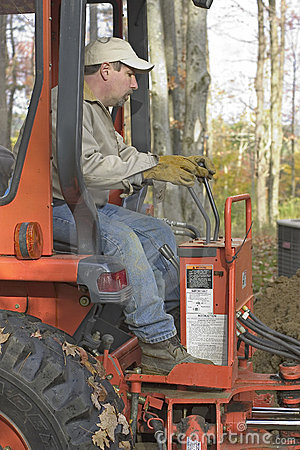Man Operating Backhoe