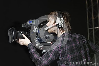 Man operating a TV Studio Camera
