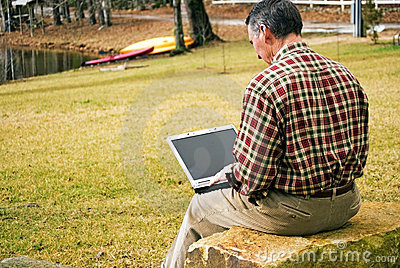 Man Outdoors with Computer