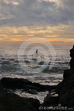 Man Paddle Surfing