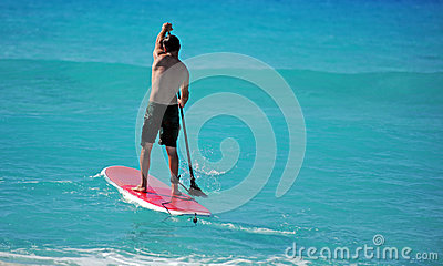 Man paddling out on paddle board