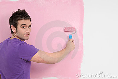 Man painting nursery wall