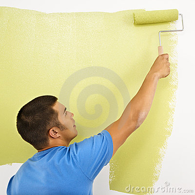 Man painting wall.