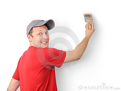 The man paints a withe wall with a brush