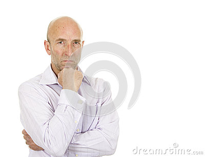 Man in pale shirt thinking
