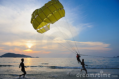 Man parasailing at sunset Editorial Photo