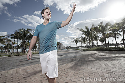 Man in the park waving