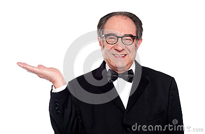 Man in party wear presenting copy space