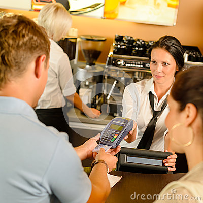 Man paying with credit card at cafe