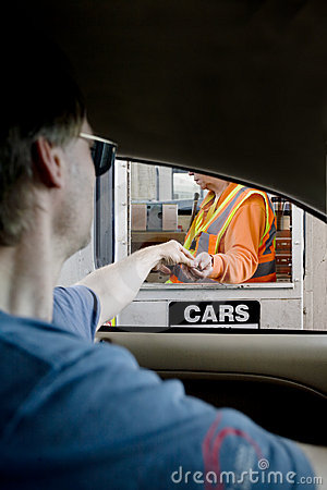 Man paying toll at toll booth