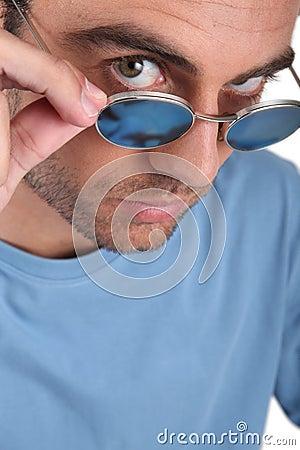 Man peering over his sunglasses