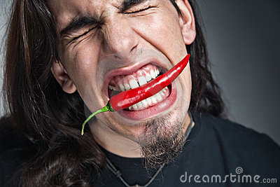 Man with pepper in his mouth