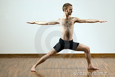 Man Performing Yoga Exercise - Horizontal