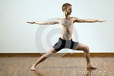 Man Performing Yoga Exercise - Horizontal