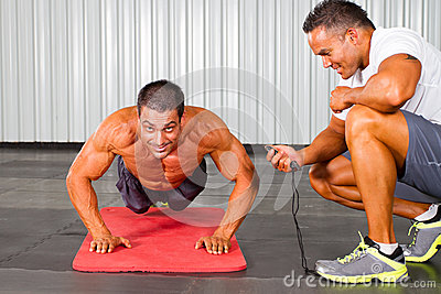 Man and personal trainer