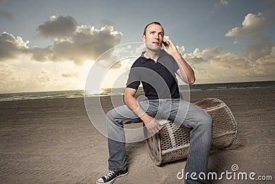 Man on the phone on the beach