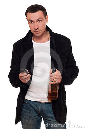 Man with a phone and bottle of scotch