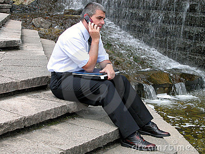 Man with phone and computer