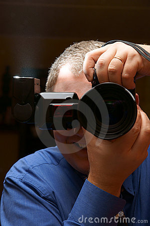 Man, photographer with dslr and flash lamp