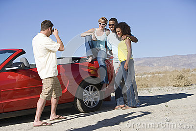 Man Photographing Friends