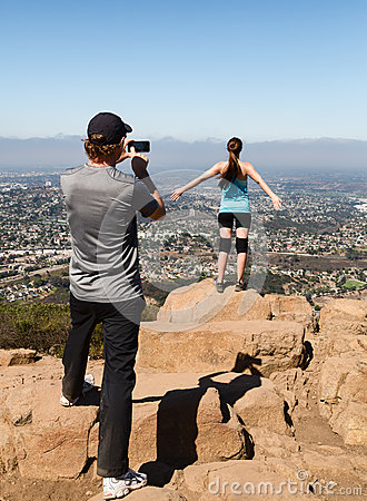Man photographing woman hiker Editorial Photography