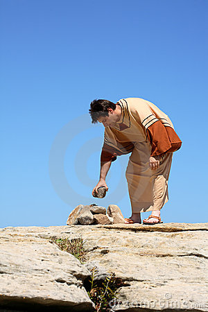 Man picking up rock  - sin