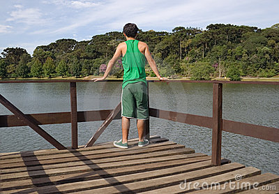 Man On Pier By Scenic Lake Stock Image - Image: 13560571