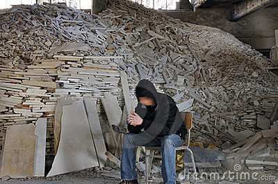 Man and pile of broken marble