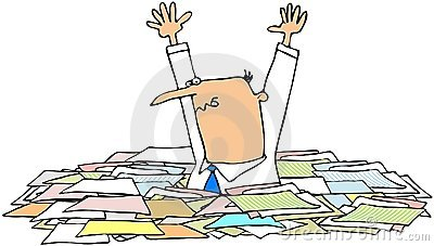Man in a pile of papers