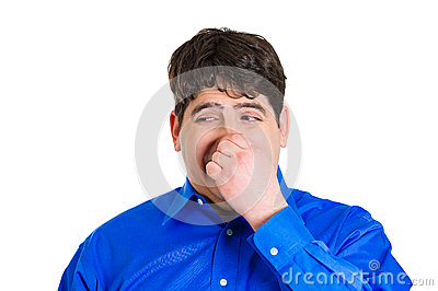 Man pinching his nose