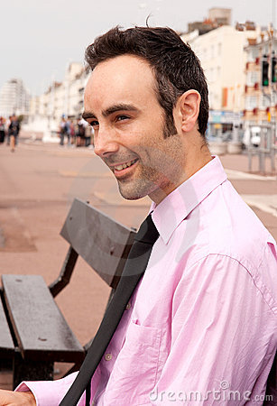 Man in pink shirt smiling