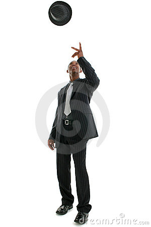 Man in Pinstriped Suit Throwing Hat Into Air