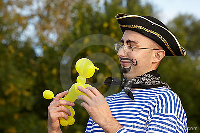 Man in pirate suit looking at doggy air-ballon.