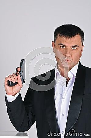 Man and pistol
