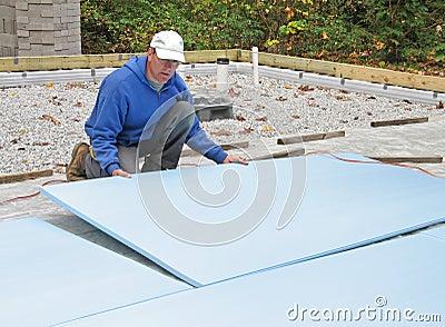 Man placing foam insulation