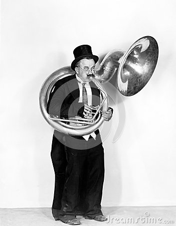 Free Man Playing A Tuba In A Top Hat Stock Photography - 52020762